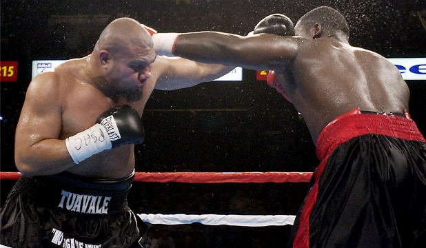 Hasim ''The Rock'' Rahman delivers a heavy right to David Tua during their bout in 2003