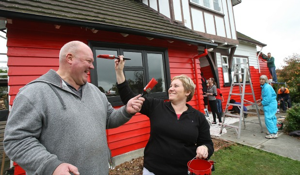 RED AND BLACK ATTACK: Timaru couple Garry and Karyn Ballantyne won a national radio competition with a twist, they had to paint the exterior of their house in a Super Rugby franchise colours.