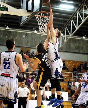 Fico Finance Nelson Giants forward Finn Delany gets up to attempt to block a shot by Taranaki's Kaye McKee.