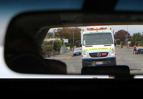 Safety comes first - even if motorists are being followed by an ambulance with sirens and lights blazing.