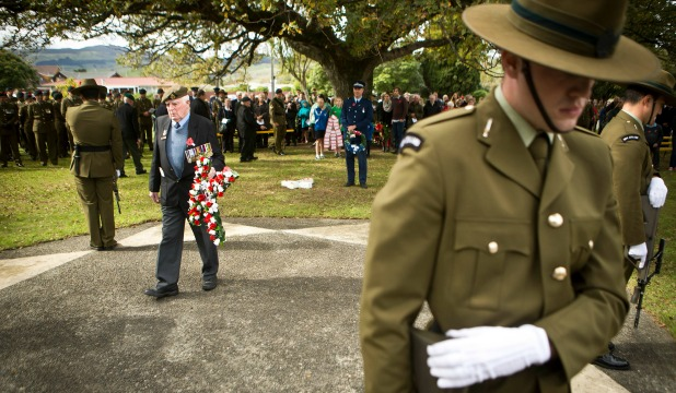 Wreaths are laid at the noon Anzac commemoration at Ashhurst village.