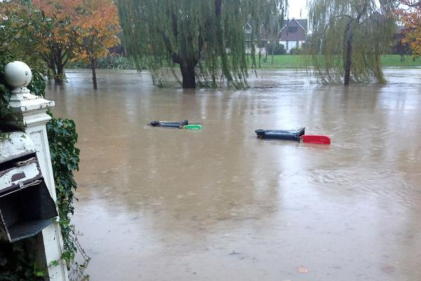 Wheelie bins float down Heathcote River