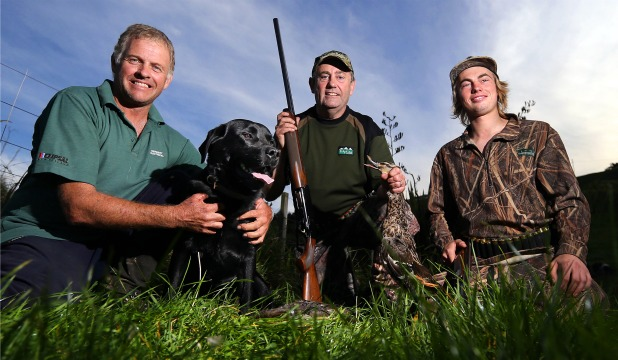 Taranaki hunter Howard Bracegirdle, with his retriever Marley, and father and son hunters Les and Rio Martin