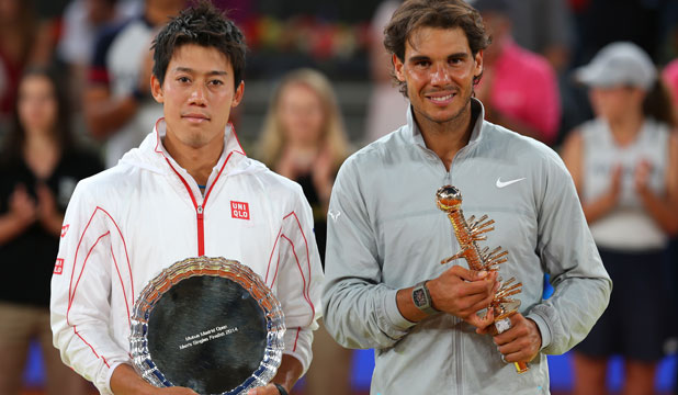 Rafael Nadal and Kei Nishikori with their Madrid Masters trophy and shield respectively, at the Caga Magica, Madrid on Sunday