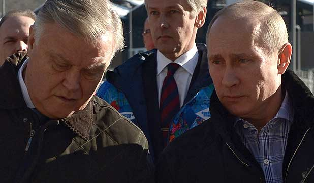 President Vladimir Putin walks with Russian Railways President Vladimir Yakunin