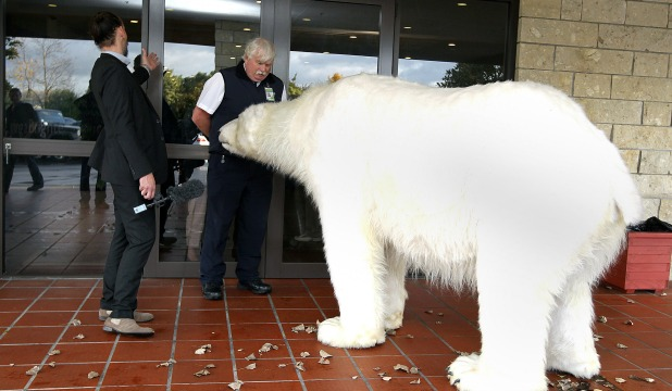 NO GO: An unexpected visitor accompanied Greenpeace energy campaigner Steve Abel to a regional National party conference in an attempt to put climate change on the agenda.