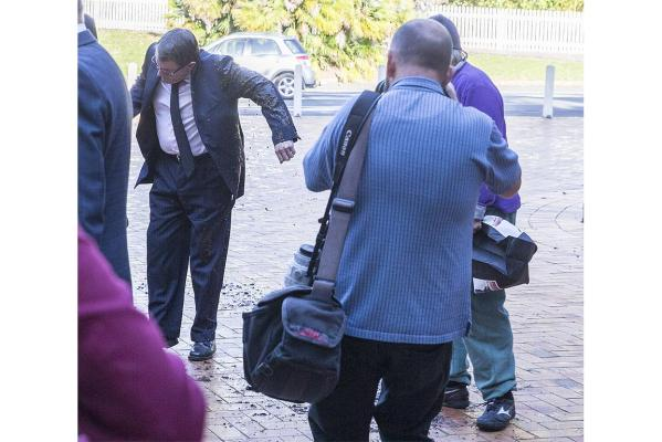 A protester threw mud across former Act leader John Bank