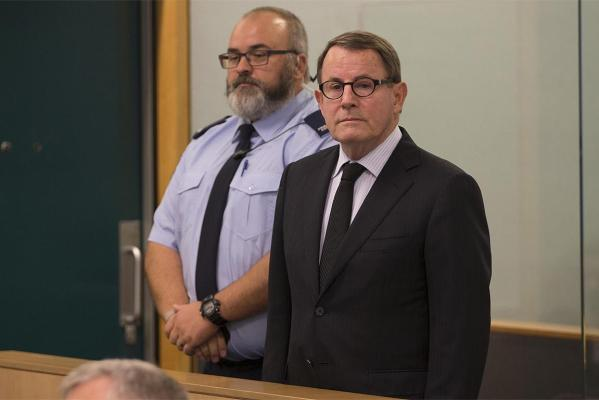 John Banks appears in the dock at Auckland High Court in a fresh suit after earlier being hit by manure.