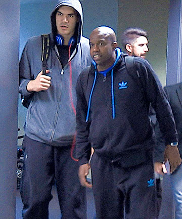 BACK HOME: Young Kiwi NBA star Steven Adams arrives Wellington Airport with mentor Kenny McFadden this morning.