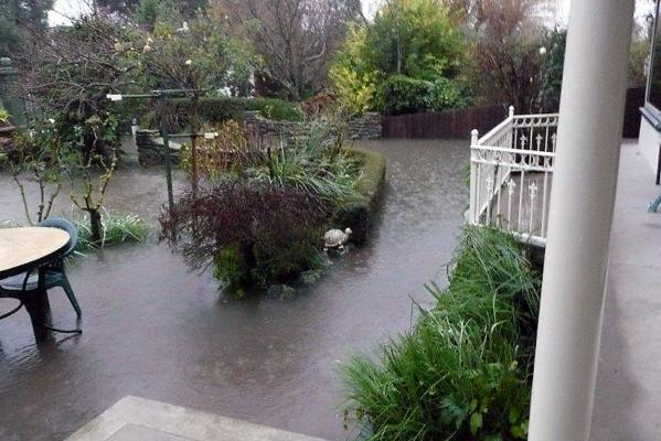 High St garden under flood