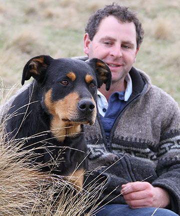 Leithen Valley farmer Terry Bould with his main huntaway Cash who won the zig-zag hunt title a