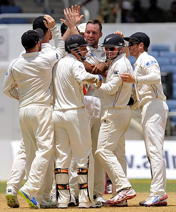 YOU BEAUTY: Mark Craig is swamped by his team-mates after taking one of his four wickets in the first innings of the Black Caps first test against the West Indies.