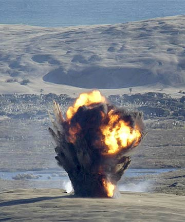 FIRE IN THE HOLE: A 500-pound bomb explodes on target at the Kaipara Air weapons range, in this shot taken in 2004.