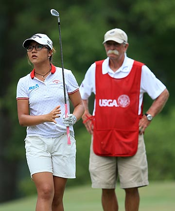 TOUGH START: Kiwi golfer Lydia Ko plays off the 15th tee as her caddie Mike 'Fluff' Cowan watches onduring the first round of the US Women's Open.