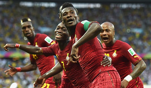 SHADOWS CAST: Ghana players celebrate after scorign a goal in their exciting 2-all draw with Germany at the World Cup. The President of Ghana's Football Association agreed for the team to play in international matches that others were prepared to rig.