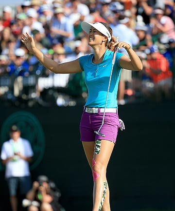 FINALLY: Former child prodigy Michelle Wie won her first major title by taking out the 2014 US Women's Open.