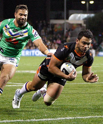 FOUR-POINTER: David Nofoaluma scores for the Tigers against the Raiders.