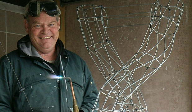 Morrinsville farmer Tony Gray at work on a wire sculpture.