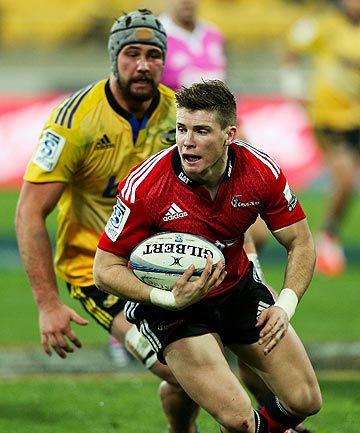 HEADS UP: Crusaders first five-eighth Colin Slade attempts to evade the tackle of Hurricanes forward Blade Thomson.