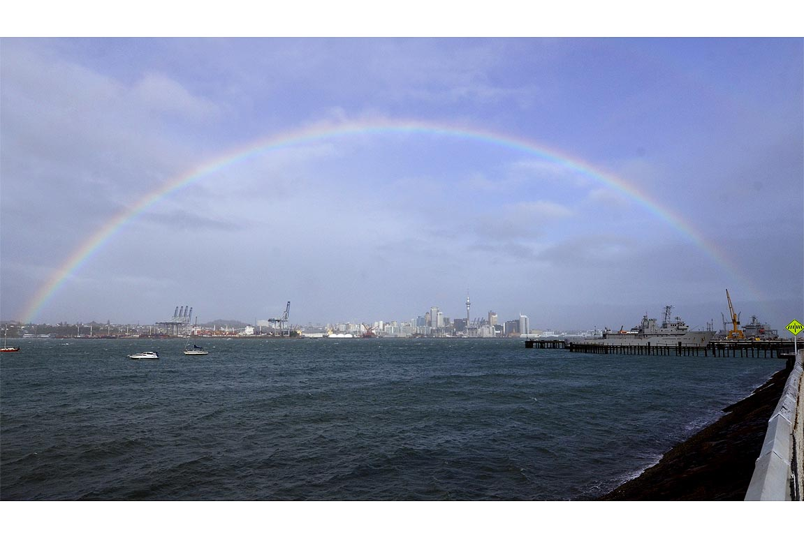 A rainbow stretches over Auckland city following rain and gale winds.