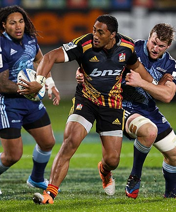 Rematch for the playoffs: Bundee Aki, of the Chiefs, looks to offload in the tackle of the Blues' Brendon O'Connor during their Super Rugby match in New Plymouth in May. Tonight, both teams are playing for a place in the playoffs.