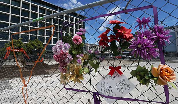 Tributes left on the CTV site's wire fence