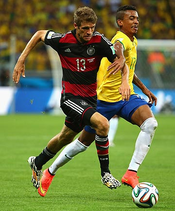 MR DECEPTION: Thomas Muller in action against Brazil.  Muller's strength is he looks ungainly but actually possesses sublime skills.