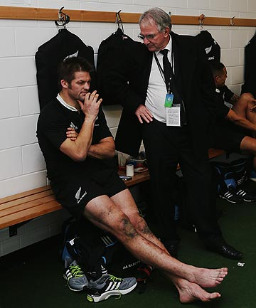 TAKING THINGS ON BOARD: Brent Impey chats with All Blacks captain Richie McCaw after the second test against England in Dunedin.
