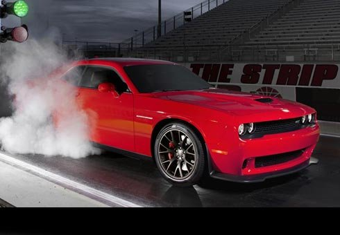Dodge ups bragging rights in the modern muscle car era with a Challenger SRT Hellcat blasting a ¼-mile run in 10.8 secs.