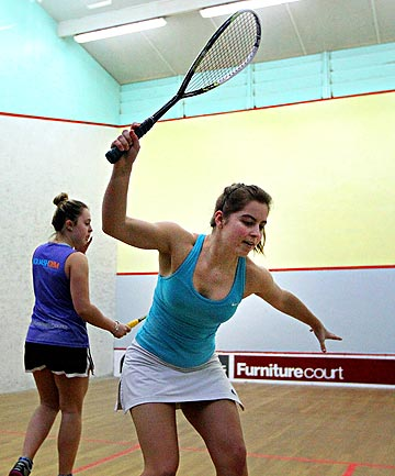 FULL SWING: Palmerston North's Rebecca Barnett returns a shot on her way to beating Danielle Fourie,  left, in a close women's open final of the Squash Central Open at the Kaw