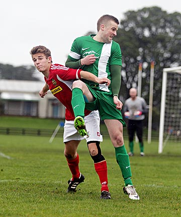 HEAD FIRST: Eltham defender Luke Kemeys heads the ball as Francis Douglas Memorial College's Connor Hay moves in to challenge for possession in a Taranaki premier grade football match in New Plymouth last Saturday.