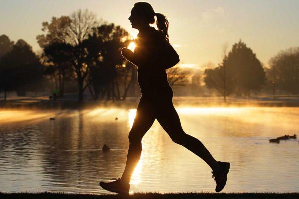 Sunrise, jogger, Hagley Park, winter morning