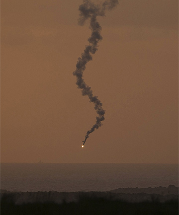 CONFLICT: Flares fired by the Israeli military above the northern Gaza Strip are seen from the Israeli town of Sderot.