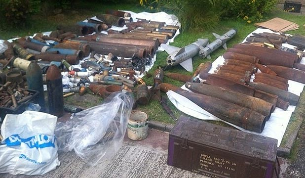 WEAPONS HAUL: What appears to be a missile is among shells recovered by the police at the man's house.