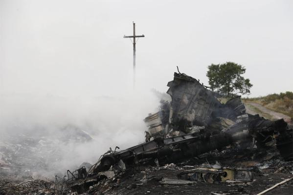 Smoke rises from the wreckage of Malaysia Airlines flight MH17.