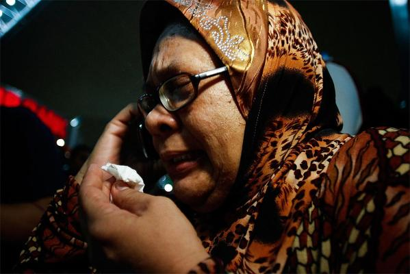A family member cries as she receives the news of the ill fated flight MH17.