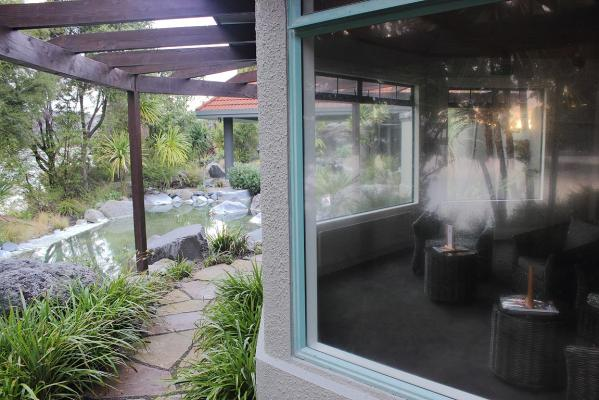 Relaxation lounge at the Polynesian Spa, looking onto the Lake Spa pools and Lake Rotorua.