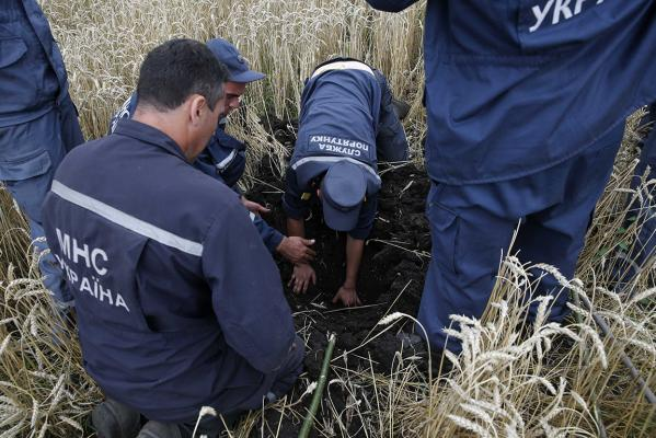 Members of the Ukrainian Emergency Ministry search for bodies near the site of Thursday'
