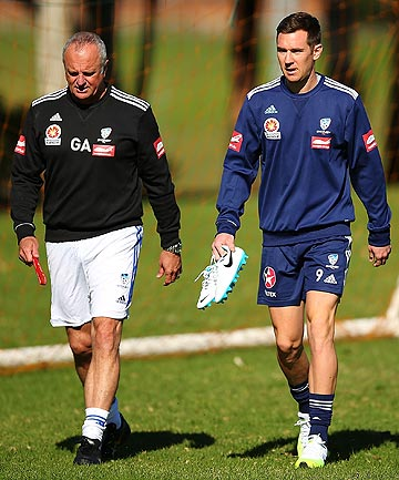 COLD: Sydney FC coach Graham Arnold and player Shane Smeltz.