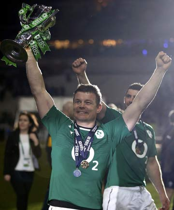 Ireland's Brian O'Driscoll holds the cup after his team defeated France at the Stade de France in Saint-Denis, near Paris, to win the Six Nations Championship.