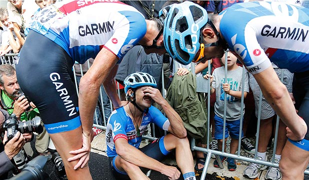 GUTTED: Kiwi cyclist Jack Bauer is consoled by team-mates after his superb effort to win stage 15 of the Tour de France came up agonisingly short.