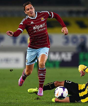 CHOPPED DOWN: West Ham player and English international Stewart Downing goes down in a challenge during his sides 2-1 upset loss to the Wellington Phoenix.