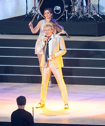 ROCKIN: World famous singer Rod Stewart gets the crowd pumping at the opening ceremony in Glasgow.