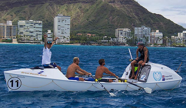 LAND AHOY: Uniting Nations, with Kiwi Craig Hackett, right taking it easy at the back, approach the finish line in Waikiki.