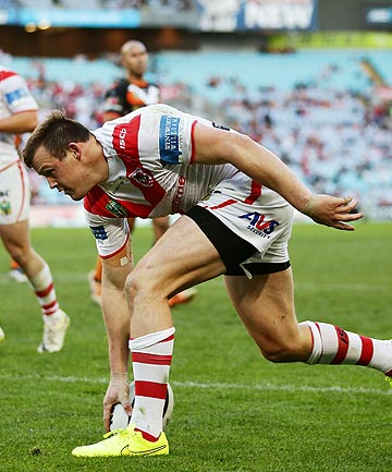 TRY TIME: Dragons winger Brett Morris goes in to score against the Wests Tigers at ANZ Stadium.