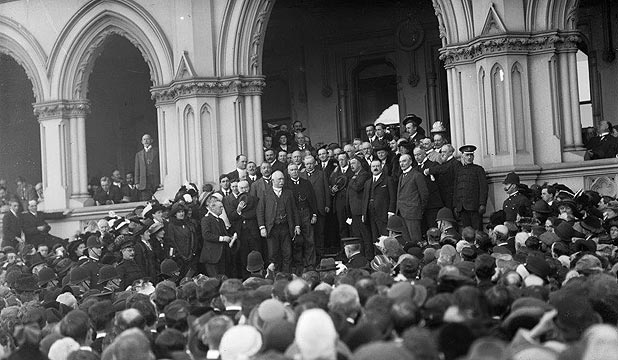 SPREAD THE NEWS: Prime Minister William Massey – in the middle of the picture, with white moustache – addresses thousands on the steps of Parliament as the country learns it has joined the looming world war.