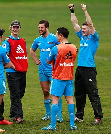 SYDNEY HERE WE COME: Colin Slade, right, makes a point while chatting to his Crusaders team-mates at training yesterday.
