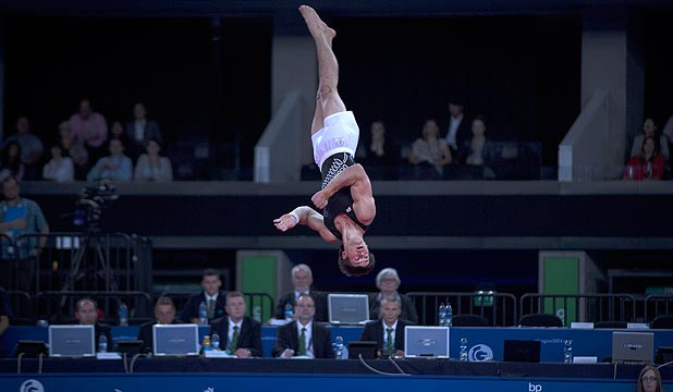 HIGH FLYER: NZ gymnast David Bishop hurls himself through the air during his bronze medal-winning floor routine at the Commonwealth Games in Glasgow.