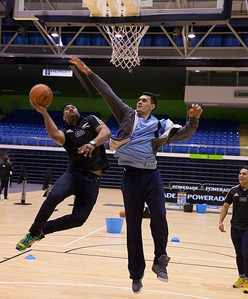STAR DUO: Kiwi NBA player Steven Adams gives All Blacks wing Julian Savea a lesson in defence during the inaugural Powerade Breakthrough Academy in Auckland this week.