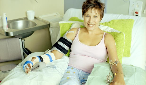 Simonne Butler, pictured a month following surgery to repair her hands after Antoine Dixon's samurai sword attack.